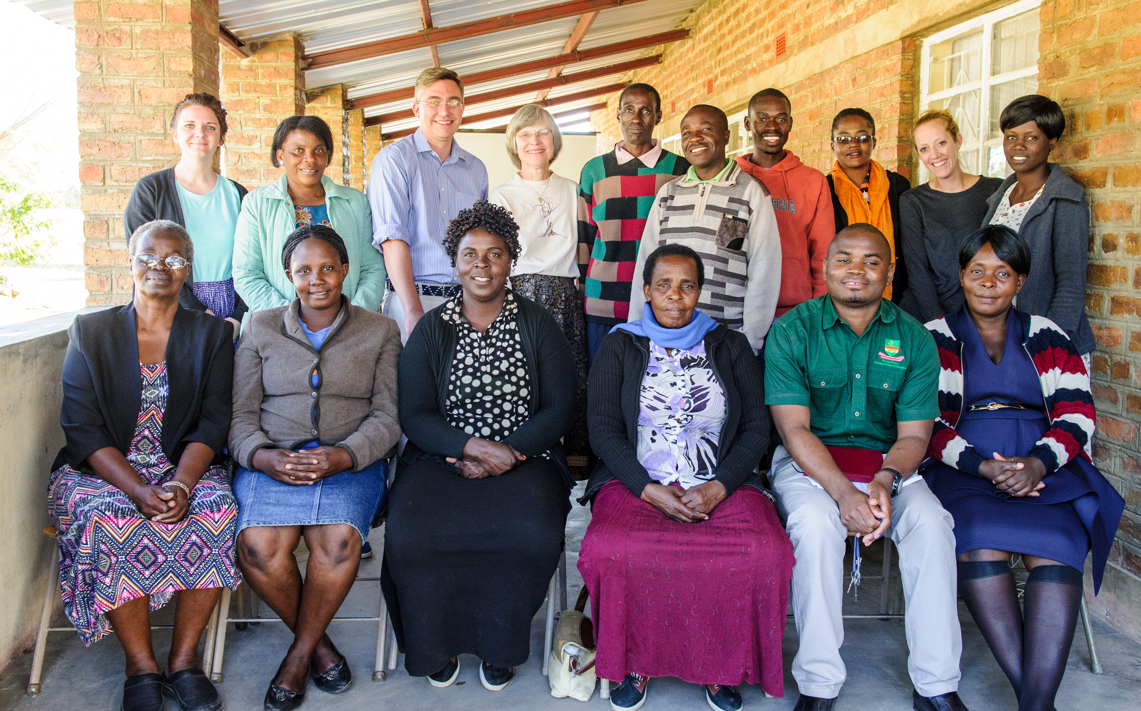 Dr. Reichow and Dr. Marylou Behnke pose with Zambian community members