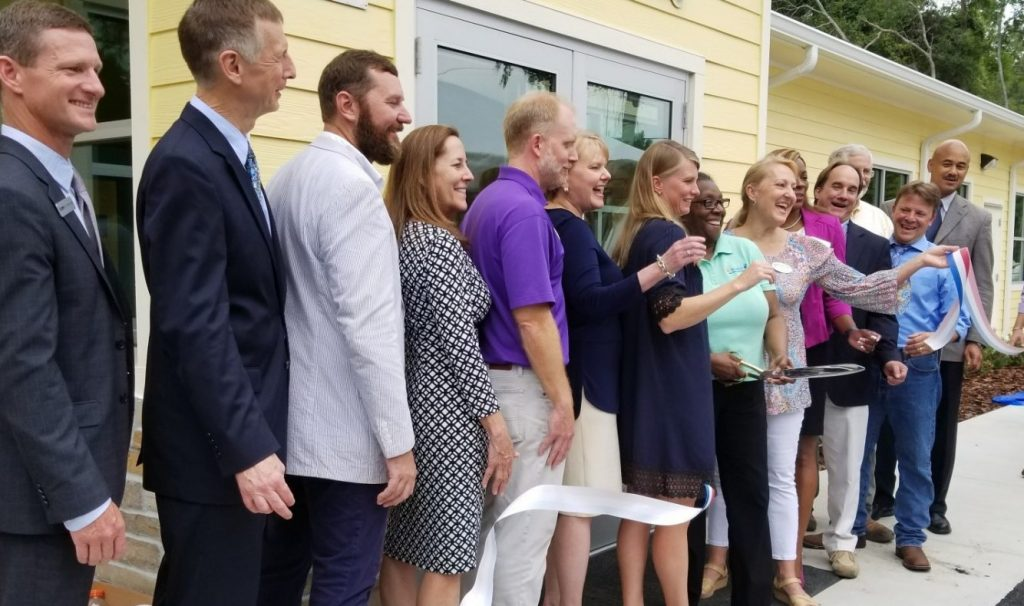 A group of people standing at the ribbon-cutting event for the CHILD Center in Gainesville, Florida.
