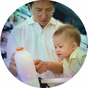 A father and son picking out milk.